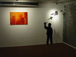 "Installation: ""Shocked and Awed."" Painted silhouette, toy jets."